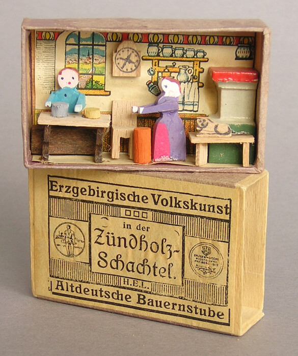 Miniaturized wooden toys in a matchbox